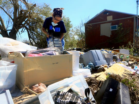 Lillian Gasca collects valuables she found at her home after it was destroyed by Hurricane Harvey on Tuesday, Aug. 29, 2017, in Bayside, Texas. Harvey struck the Texas Coastal Bend as a Category 4 Friday, August 25, 2017.