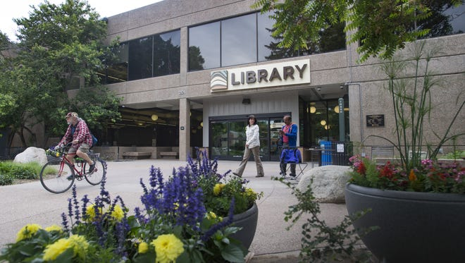 People visit the Old Town Library on Tuesday, June 13, 2017.