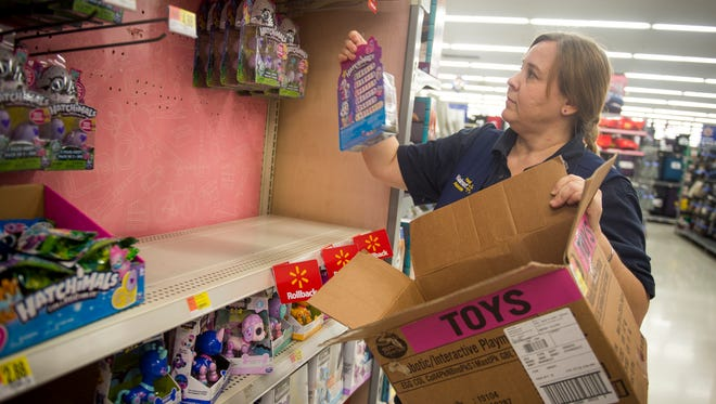 Toy department manager Debra Johnson restocks the shelves with various toys at the Walmart on Walbrook Drive in Knoxville on Tuesday, Nov. 21, 2017.