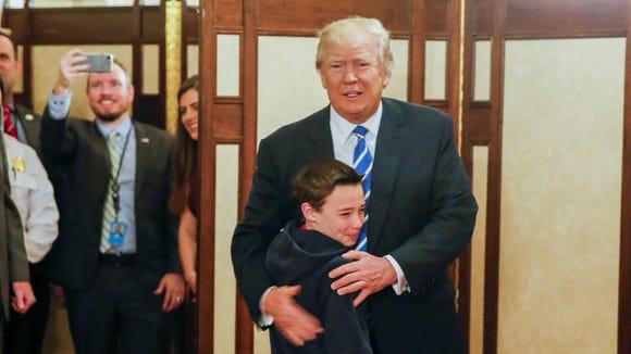 President Donald J. Trump greets Jack Cornish, 10,