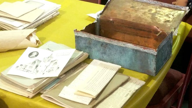An opened, lead-box time capsule from 1904, and documents from it, are displayed at a special farewell ceremony at First Latin American Baptist Church on Fort Street in Detroit on Saturday, November 18, 2017.