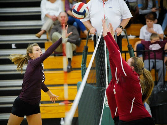 Henderson County's Hannah Watkins (3) hits the ball past Madisonville's Madison McCabe (14) and Madisonville's Rachel Wilson (16) during their Second Region volleyball tournament game at University Heights Academy in Hopkinsville, Wednesday, Oct. 26, 2016. Henderson County beat Madisonville 3-0.