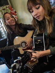 Sarina and Nalani Bolton, a twin sister duo from Flemington, perform one of their original songs on Jan. 6 at the Dragonfly Music & Coffee Cafe in Somerville.