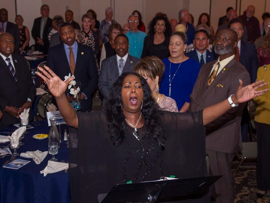 Bobbie Green, a local NAACP officer, leads the NMSU Gospel Choir's opening song at the Juneteenth Celebration of Freedom Banquet held Saturday, June 16, 2018, at the Hotel Encanto de Las Cruces.