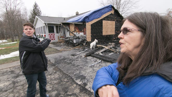 Mindi Patterson, left, and mother Regina Patterson talk Thursday, Dec. 21, 2017  talk about the damage to the Pattersons' home, destroyed by fire days after the funeral of Regina's son Tommy.