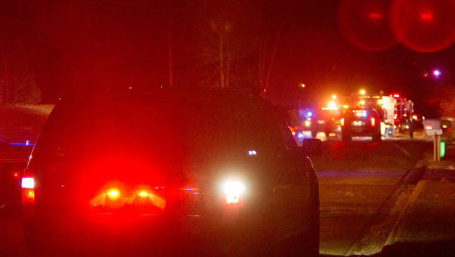 Livingston County EMS as well as Sheriff's deputies and fire personnel block off Latson Road south of Merriman Loop Wednesday, Jan. 31, 2018 as they investigate a fatal crash involving one car.