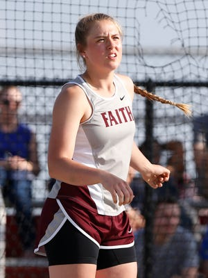 Madi Schultz of Faith Christian watches her throw in the discus during the Girls Track and Field Regional Tuesday, May 22, 2018, at Lafayette Jeff. Schultz advanced to state with a throw of 127 feet.
