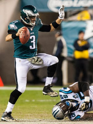 Philadelphia quarterback Mark Sanchez breaks away from a sack attempt by Carolina's Charles Johnson in the third quarter of an NFL football game between the Carolina Panthers and Philadelphia Eagles at Lincoln Financial Field in Philadelphia, Pa. on Monday night, November 10, 2014.