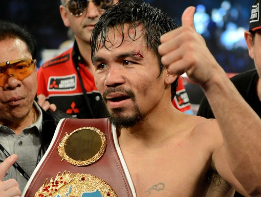 041214-manny-pacquiao-with-belt