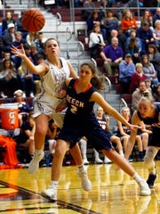 Station Camp's Jane Deason (20) tries to save the ball