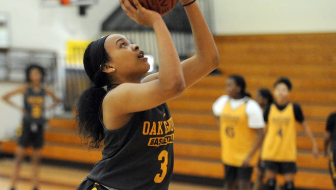 Oak Grove junior Lekera Hughes shoots for the basket during practice on Monday.
