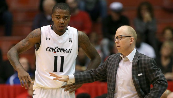 Cincinnati Bearcats forward Gary Clark (11), left, talks with Cincinnati Bearcats head coach Mick Cronin in the first half during the NCAA college basketball game between the Norfolk State Spartans and the Cincinnati Bearcats, Tuesday, Dec. 15, 2015, at Fifth Third Arena in Cincinnati.