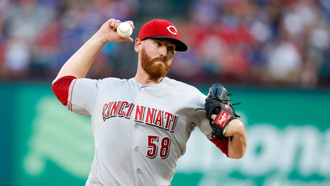 Cincinnati Reds starting pitcher Dan Straily (58) throws a pitch in the fifth inning against the Texas Rangers at Globe Life Park in Arlington. Mandatory Credit: Tim Heitman-USA TODAY Sports