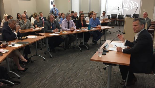 N.C. Attorney General Josh Stein, right, speaks with local public officials and health care providers about opioids in Asheville Tuesday.