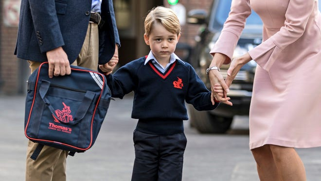 """Husnain Rashi is accused of sharing information about Prince George's school on an encrypted messaging app, accompanied by a photo of the toddler, a silhouette of a jihadist and the message """"even the royal family will not be left alone."""""""