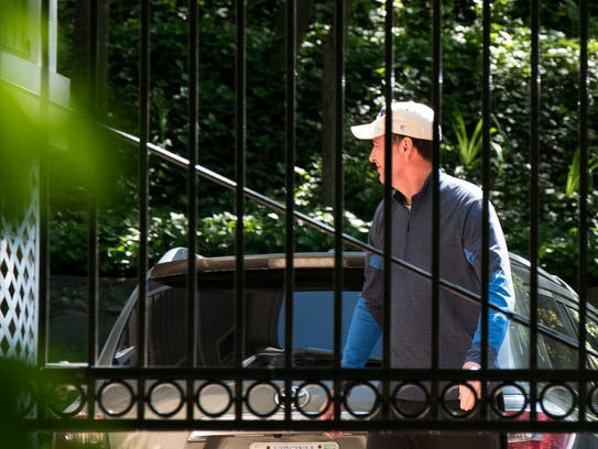 Former FBI director James Comey walks at his home in