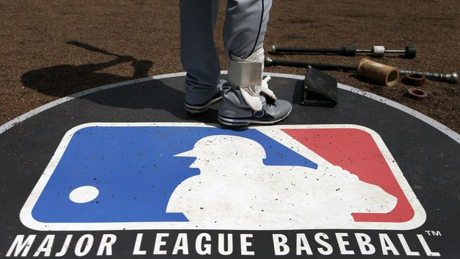 Cleveland Indians second baseman Jason Kipnis stands on the Major League Baseball logo that serves as the on-deck circle during a game against the Chicago White Sox in 2013. The league and the players remain far apart in negotiations for a restart plan.