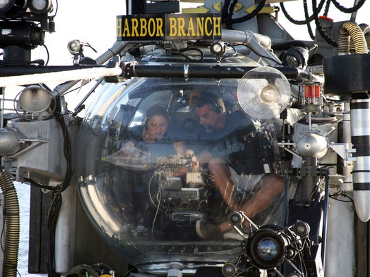 Harbor Branch's Dr. Esther Guzmán receives instructions from submersible pilot Frank Lombardo prior to a collecting trip.