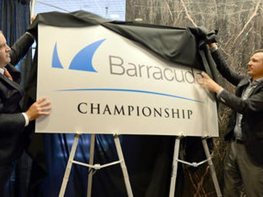 Chris Hoff, tournament director for the Reno Tahoe Open, left, and Michael Hughes with Barracuda unveil the new name and logo for the tournament at Reno City Hall on Wednesday.