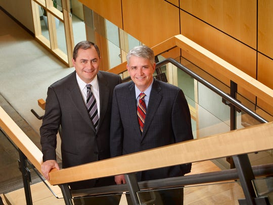 Nicolet National Bank CEO Mike Daniels, left, and Chairman