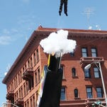 """""""The Cannon Lady"""" is blasted out of a truck-mounted cannon in front of the Finlen Hotel on East Broadway during the opening day of Evel Knievel Days in uptown Butte in 2011."""