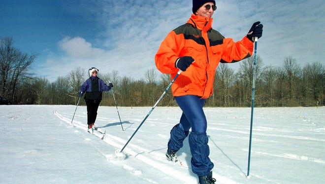 12.31.98     Lori Podkyl, left, and Chris Kunkel, right, both of Indianapolis enjoy cross country skiing at Eagle Creek Park Thursday, December 31, 1998 after 1.7 inches of snow fell according to the National Weather Service bringing the winter total to 1.9 inches of snow.