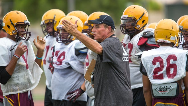 Phoenix Mountain Pointe head coach Norris Vaughan talks to his players during a practice on Aug. 12, 2014.