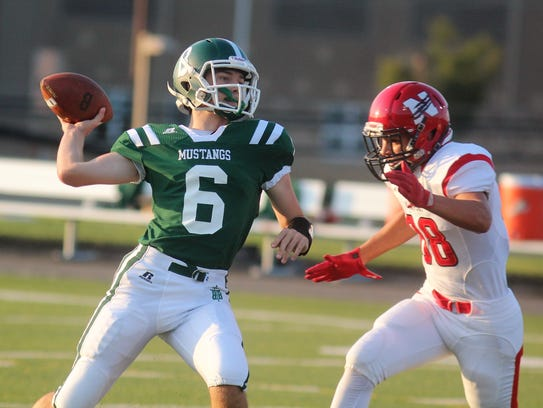 Brossart junior Tyler MacDonald throws a pass during