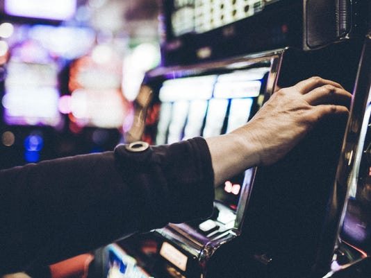 Hand of a 59 year old woman playing a slot machine in one of Las Vegas casinos.