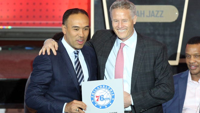 Philadelphia 76ers head coach Brett Brown (right) poses with NBA deputy commissioner Mark Tatum after the 76ers receive the first pick in the 2016 NBA draft during the NBA draft lottery.