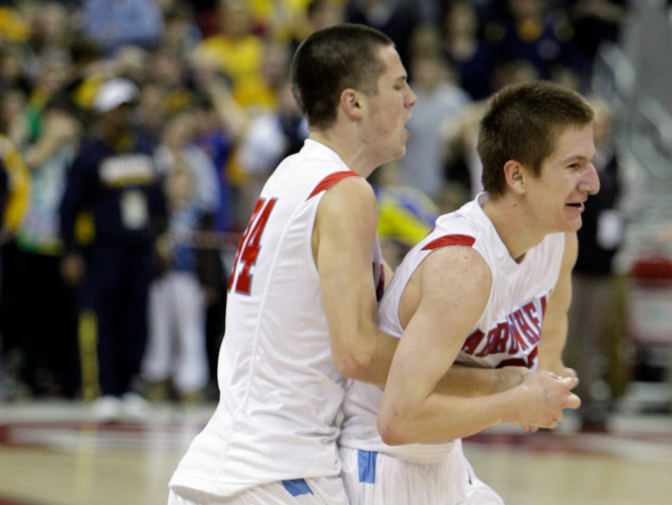 Arrowhead's Charles Rushman is embraced by teammate Ryan May after making the game-winning shot during a state semifinal game March 19, 2010. Arrowhead went on to defeat Madison Memorial one night later in the state title game.