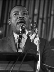 Martin Luther King Jr speaking to an audience at Brown