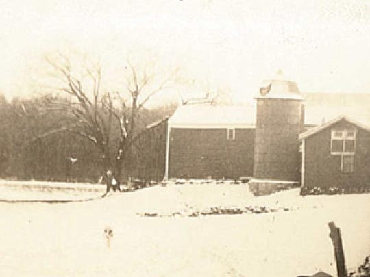 The barns on the Osika farm are shown in 1945.