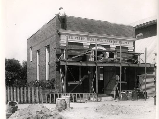 A construction worker working on the 100 year old building