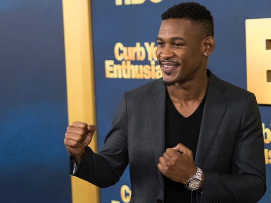 """FILE - In this Wednesday, Sept. 27, 2017, file photo, boxer Daniel """"Danny"""" Jacobs attends the premiere of HBO's """"Curb Your Enthusiasm"""" at the SVA Theatre on, in New York. Jacobs is heading back into the ring, determined to build off a defeat that, in many ways, was a victory.  Jacobs will fight Luis Arias on Nov. 11 at the former Nassau Coliseum, now called NYCB Live, his first bout under a promotional agreement with Ed Hearn that he hopes will lead him back to a title. (Photo by Charles Sykes/Invision/AP, File)"""