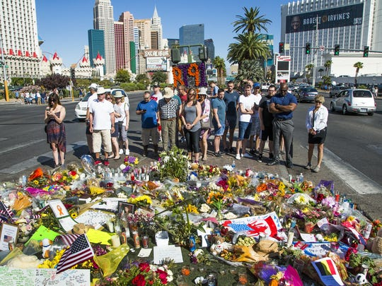 People on Oct. 5, 2017, visit the memorial in the middle of Las Vegas Boulevard, across from the scene of last week's massacre.