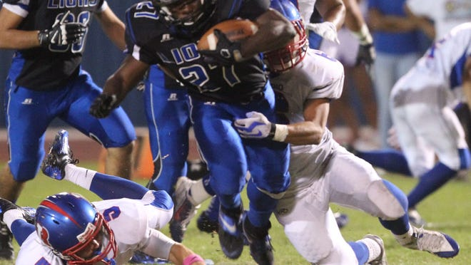 Cathedral City High School's Joshua Mosley runs for yardage against Indio High School during their game Friday at Cathedral City.