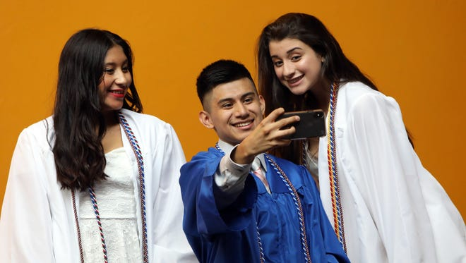 Erick Zhinin snaps a selfie with Kelly Alvarez, left, and Katherine Bhanote during the Hendrick Hudson High School graduation at SUNY Purchase June 24, 2018.