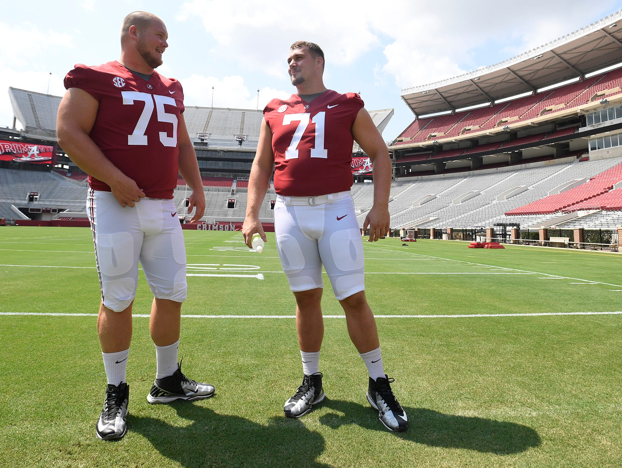 Alabama offensive lineman Bradley Bozeman (75) and offensive lineman Ross Pierschbacher (71) before fan day in Tuscaloosa, Ala. on Saturday August 5, 2017.