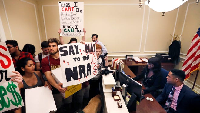 This Feb. 21 photo shows students at the entrance to the office of Florida Gov. Rick Scott with boxes of petitions for gun control reform at the state Capitol in Tallahassee.