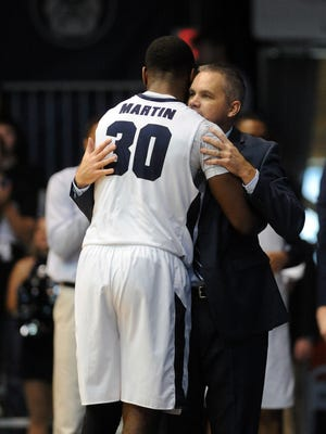 Butler Bulldogs head coach Chris Holtman hugs Butler Bulldogs guard  Kelan Martin (30) during game against the Indiana State Sycamores in the second half at Hinkle Fieldhouse. The  Butler Bulldogs went on to defeat the Indiana State Sycamores, 85-71.