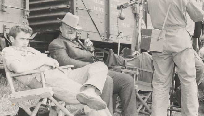 James Dean and Burl Ives wait for the next scene