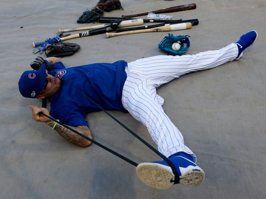 Chicago Cubs' Javier Baez works out during practice before baseball's National League Championship Series against the Los Angeles Dodgers, Friday, Oct. 14, 2016, in Chicago. The Cubs host Game 1 of the series against the Dodgers on Saturday. (AP Photo/Charles Rex Arbogast)