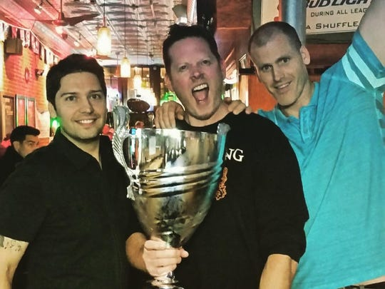 "Win the ""Lord Shufflepuck Cup"" at the Asbury Ale House during this year's shuffleboard league competition."