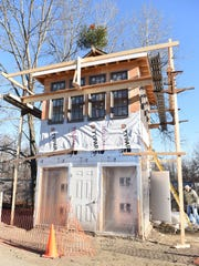 A view of the Hopewell Depot restoration project, which is a replica of the 1892, two-story signal tower that was torn down in 1938. The tower is under construction across from the restored depot at the southern end of the William R. Steinhaus Dutchess Rail Trail in Hopewell Junction.