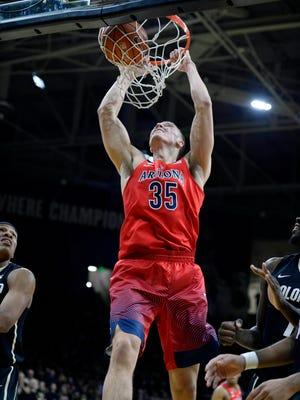 Arizona Wildcats center Kaleb Tarczewski (35) finishes off a basket in the second half against the Colorado Buffaloes at the Coors Events Center. The Buffaloes defeated the Wildcats 75-72.