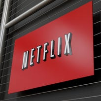 The Netflix logo at company headquarters in Los Gatos, Calif. Several Des Moines attorneys said it is not illegal to share passwords for Netflix or other pay services. User policies caution against sharing passwords for security reasons.