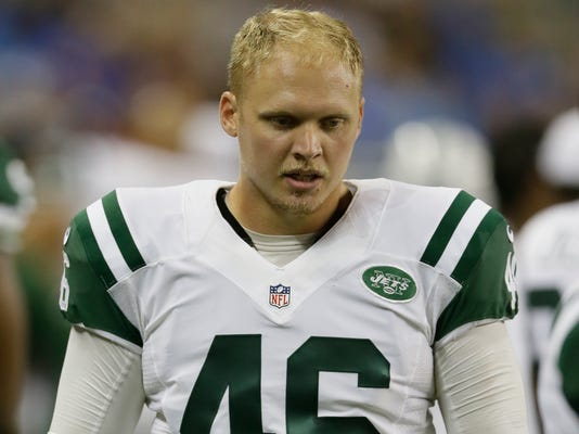 FILE - This is an Aug. 13, 2015, file photo showing New York Jets long snapper Tanner Purdum (46) during the first half of an NFL preseason football game against the Detroit Lions in Detroit. As the family legend goes, Tanner Purdum was about 3 years old when he reached down and grabbed a football, crouched and launched it between his legs for the first time. The ball didn't travel very far, but a long snapper was born. (AP Photo/Duane Burleson, File)