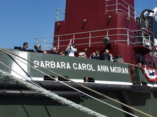 Barbara Carol Ann Moran christens the tugboat of her namesake at Bay Shipbuilding Co. on Friday, May 20.