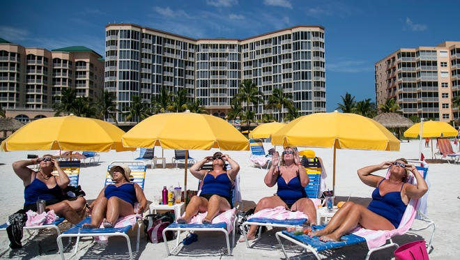 A group of friends from northern Kentucky gathered at the Pink Shell Resort at Fort Myers Beach. This February was the hottest on record for Southwest Florida.